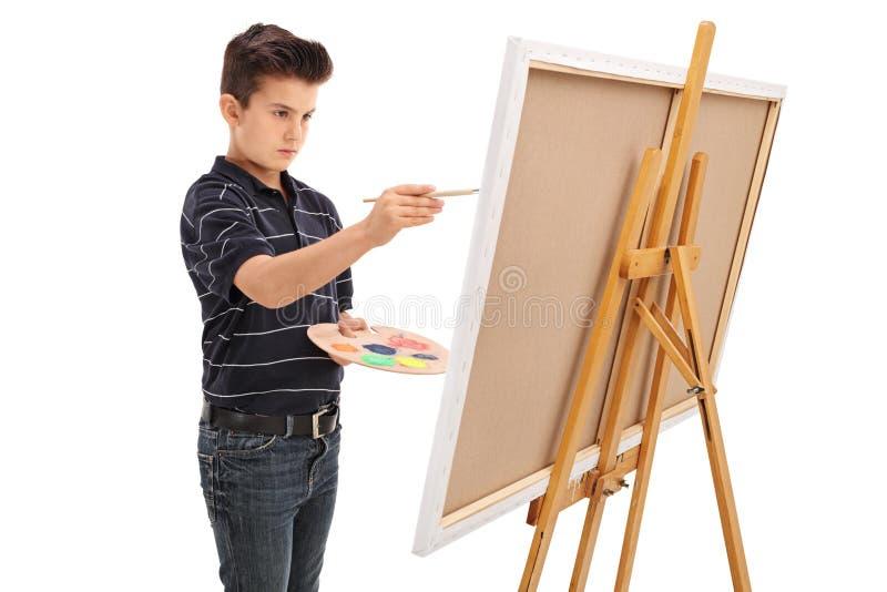 Målning för liten unge på en kanfas fotografering för bildbyråer