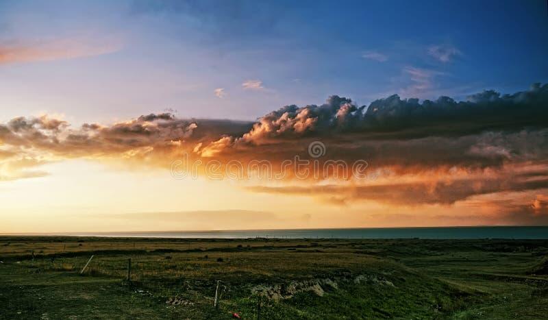 målning för olja för landskap för glöd för molnsolnedgångsolnedgång arkivfoton