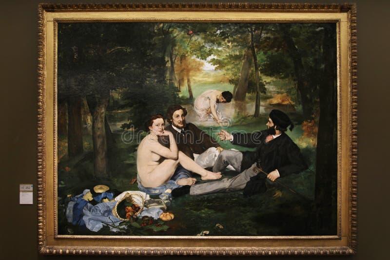 Målning`-frukost på gräs`en av Eduard Manet 1863 Lokaliserat i `en Orsay för museum D paris 01 10 2011 royaltyfri fotografi