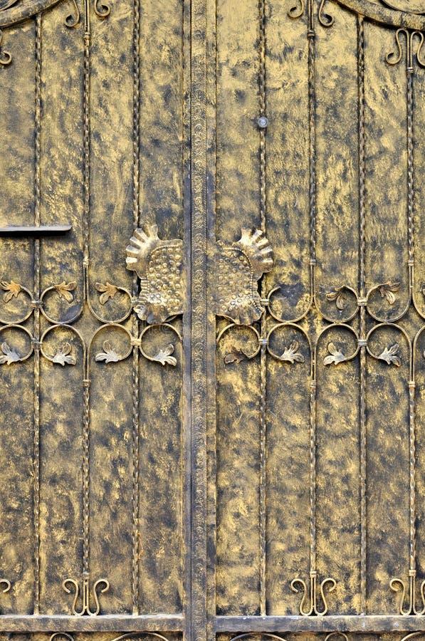 Målningdörren I Guld- Färgar Arkivbild