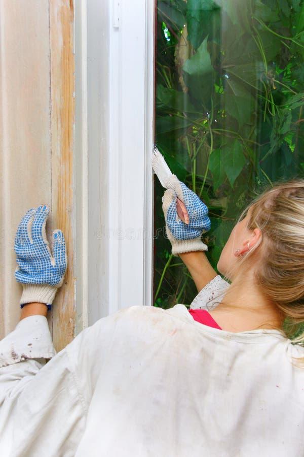 målningsfönsterkvinna arkivbilder