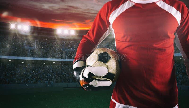 Målvakt som är klar att spela med bollen i hans händer på stadion arkivfoto