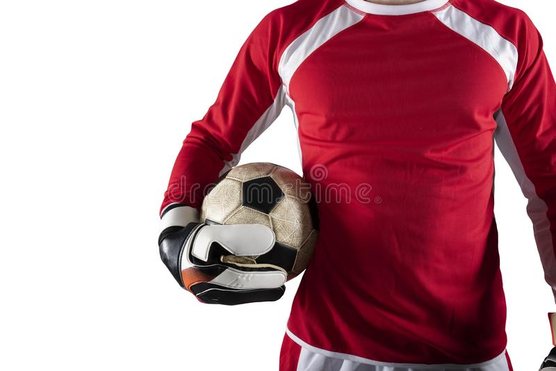 Målvakten rymmer bollen i stadion under en fotbolllek bakgrund isolerad white arkivbilder