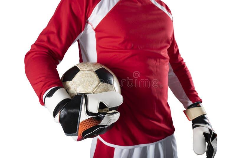 Målvakten rymmer bollen i stadion under en fotbolllek P? vitbakgrund arkivbilder