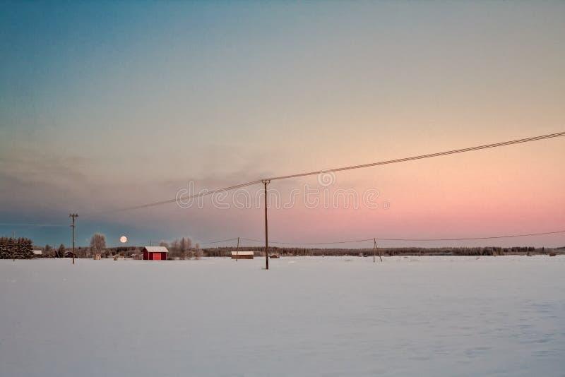 Måne och soluppgång royaltyfri foto