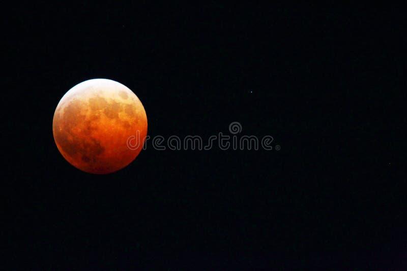 Månförmörkelse och Uranus arkivbild