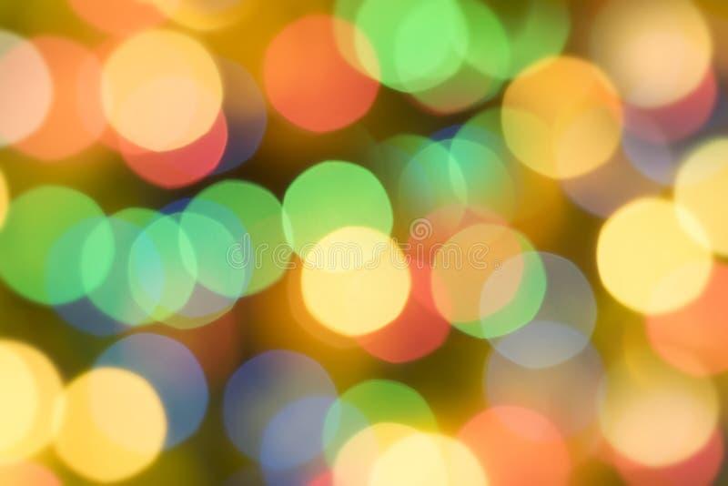 Mång--färgade cirklar och en suddig bakgrund arkivfoto