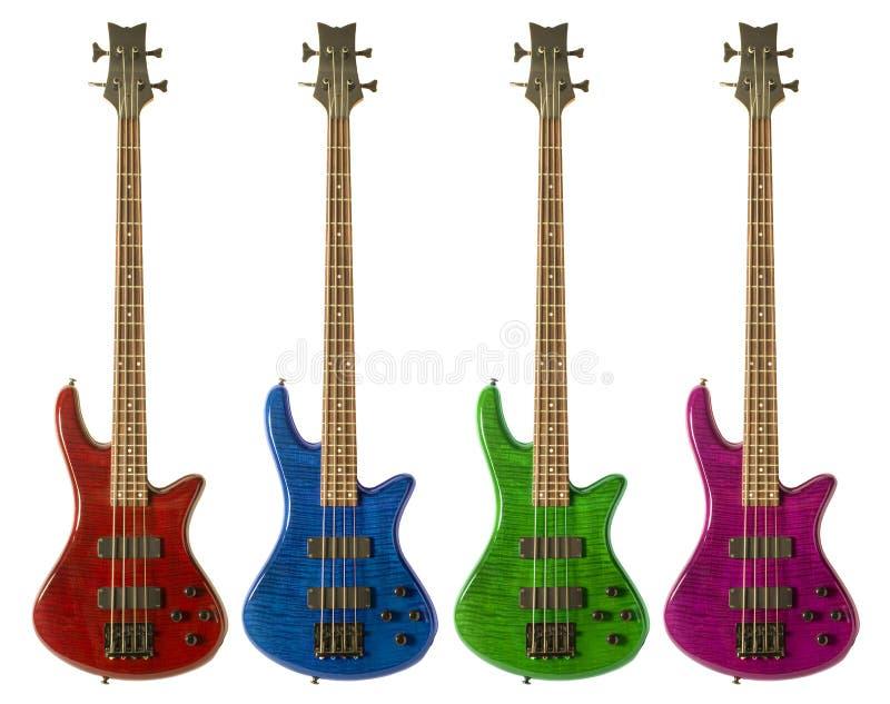 mång- kulöra gitarrer för bas royaltyfria foton