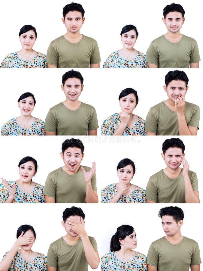 Mång- uttryck för asiatiska par som isoleras på vit royaltyfria foton