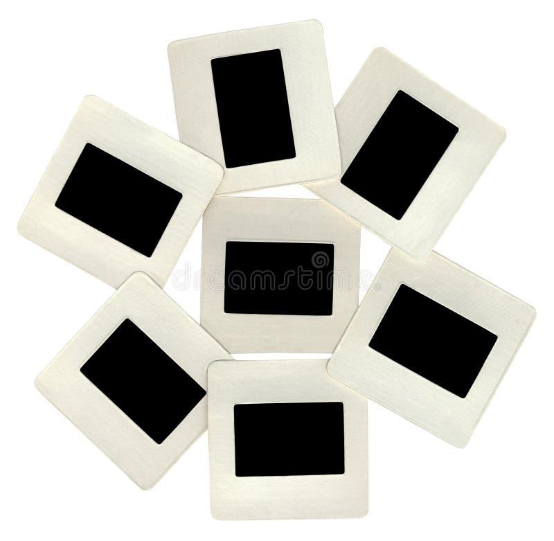 Många blackglidbanor med vita ramar, lightbox royaltyfria bilder