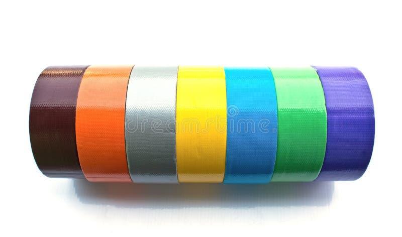 Många färgar bindemedel tejpar fotografering för bildbyråer