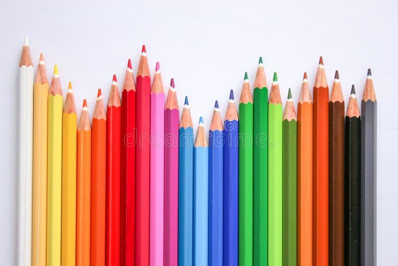 Många färgrika pennor i flera ordningar royaltyfria bilder