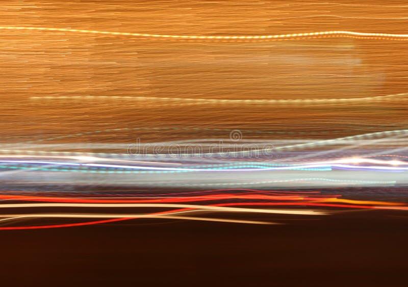 Många ljust färgrikt flytta sig för ljus som är horisontal på svart bakgrund royaltyfri bild