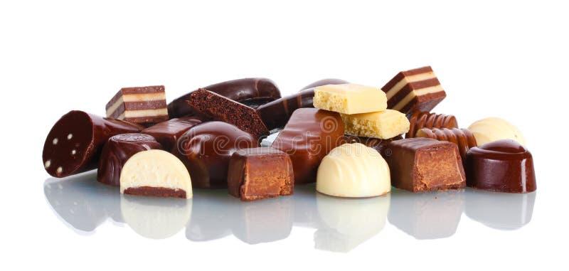 Många olik chokladgodis royaltyfri bild