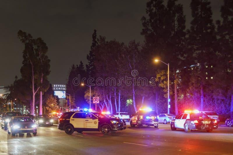 Många polisbilar som blockerar vägen nära den Beverly mitten royaltyfri foto