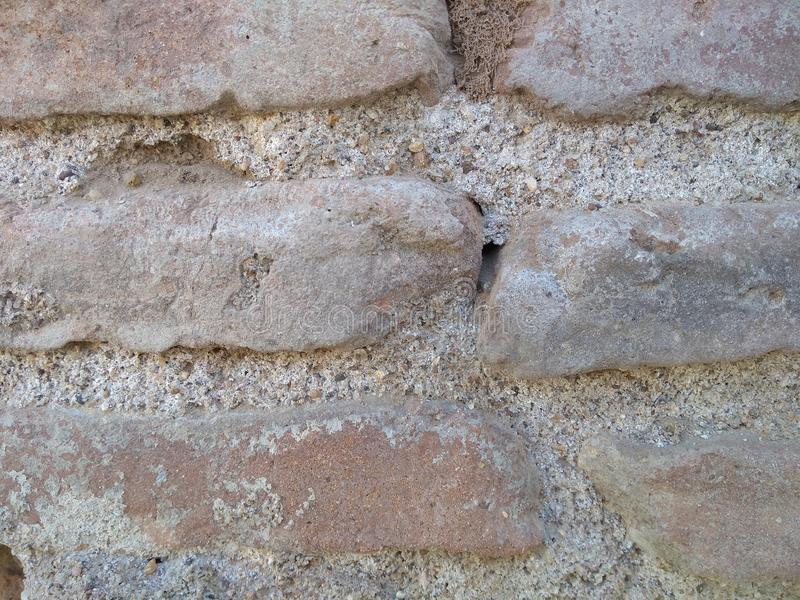 många tegelstentegelstenar gammal texturvägg royaltyfri bild