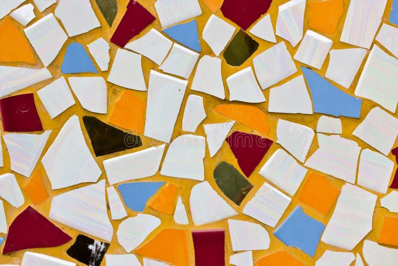 Mångfärgade små tegelplattor arkivbild