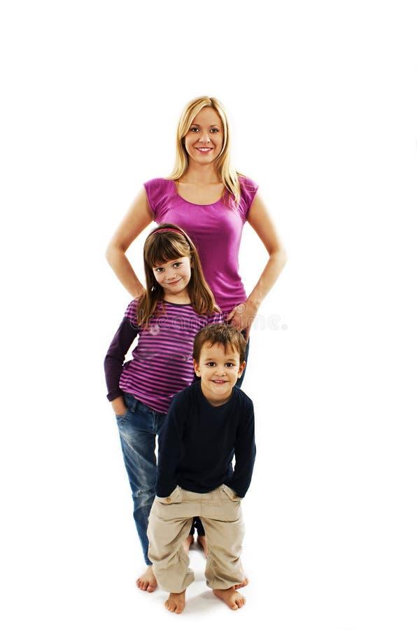 Mère assez jeune avec le fils et la fille images stock