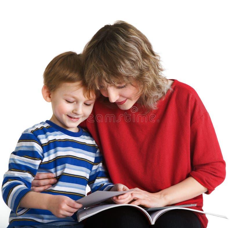 mère d'enfant de livre affichée photo stock