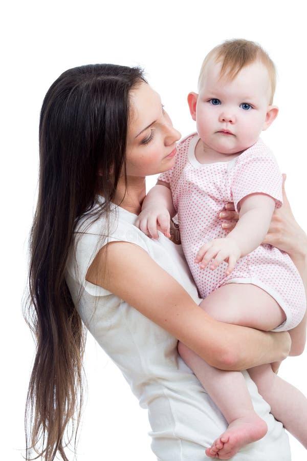 Mère mignonne avec le bébé photographie stock