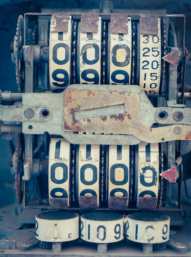 Mètre analogue d'huile de vintage d'une pompe, chiffres de la pompe à huile mécaniques photographie stock