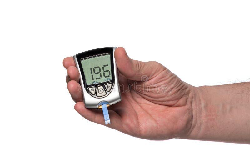 Mètre de glucose sanguin pour vérifier le taux du sucre dans le sang photos libres de droits