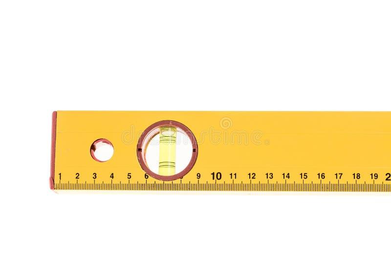 Mètre jaune de niveau de bloc avec la bulle photo stock