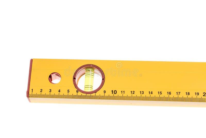 Mètre jaune de niveau de bloc avec la bulle images stock