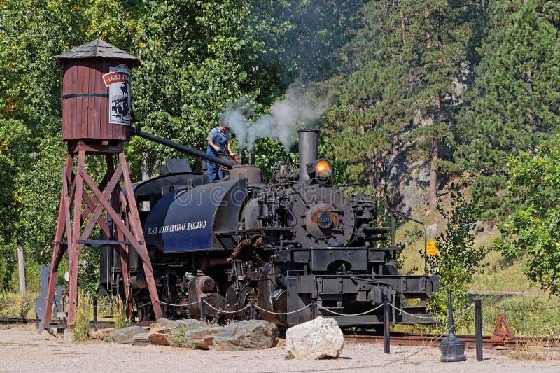 Mécanicien sur la locomotive très vieille photographie stock