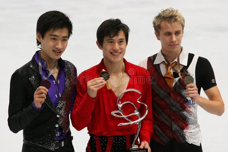 Médaillés dans le patinage simple des hommes photographie stock