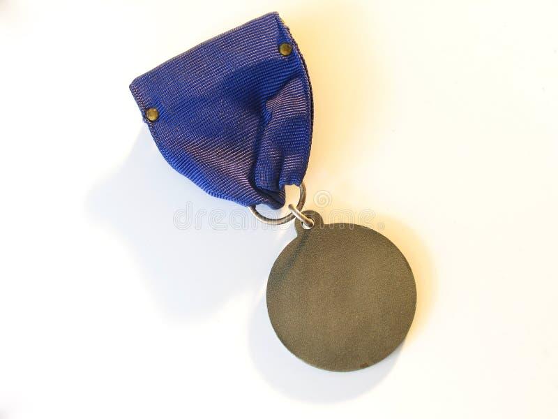 Médaille blanc photographie stock