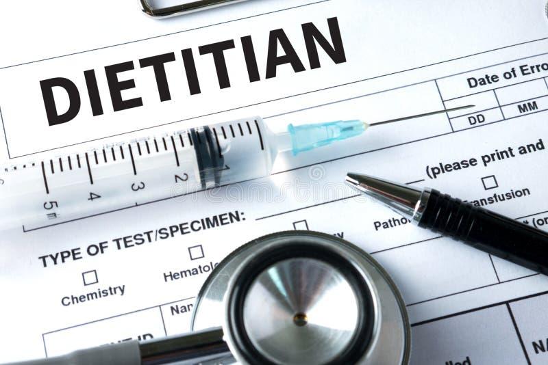Médecin de DIÉTÉTICIEN et de nutritionniste ou diététicien et diététicien pro photo libre de droits
