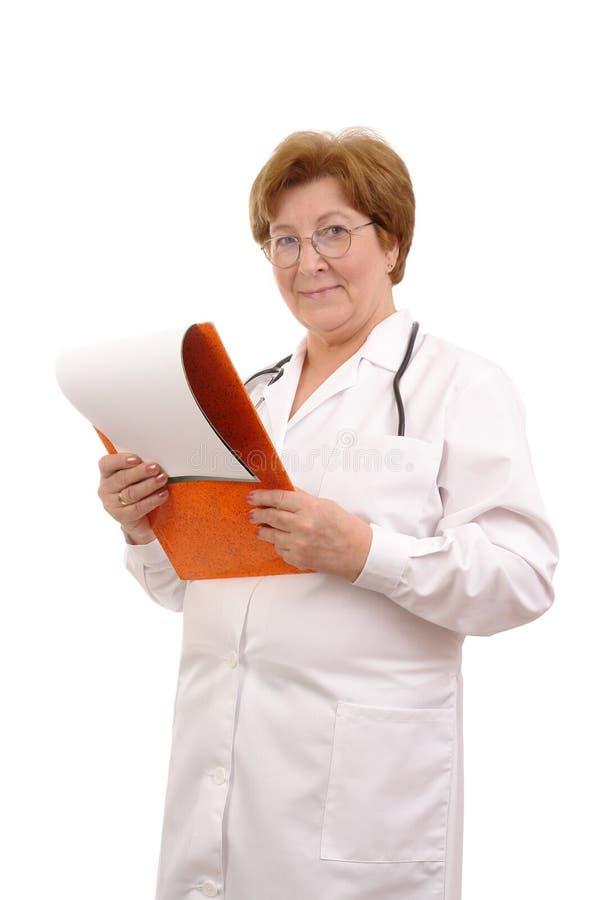 Médecin de famille aîné photo libre de droits