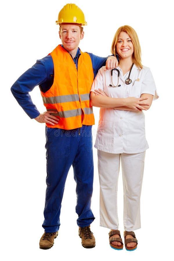 Médecin et travailleur de la construction de société photographie stock