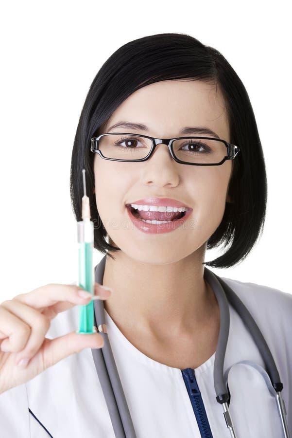 Médecin ou infirmière avec la seringue image stock