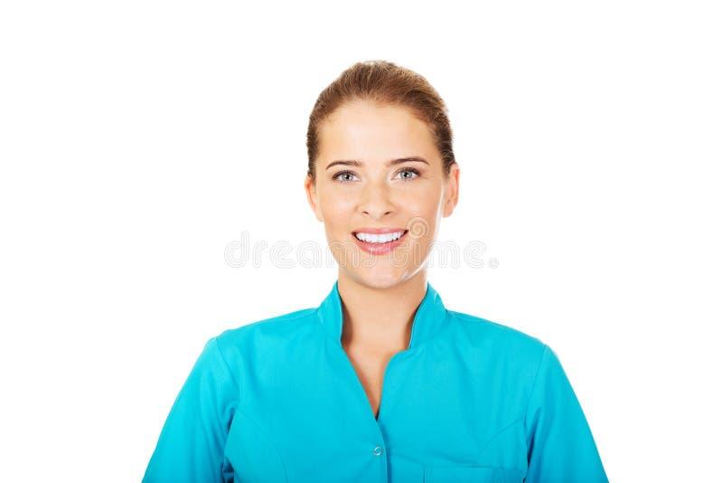 Médecin ou infirmière féminin de sourire de jeunes image libre de droits