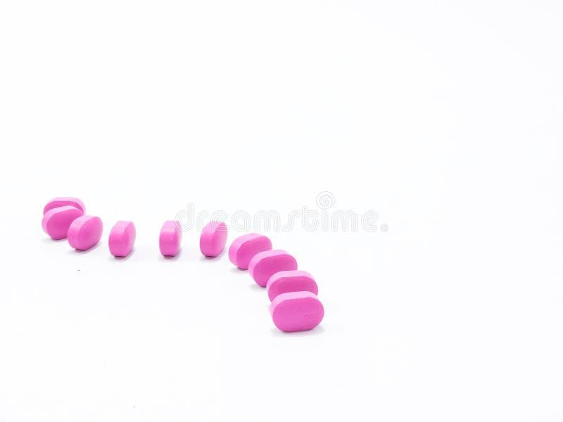 Médecine rose sur le ressembler d'isolement par fond blanc de l'espace de copie de wihe au domino image stock