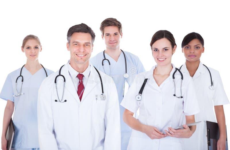 Médecins et infirmières avec le stéthoscope photos stock