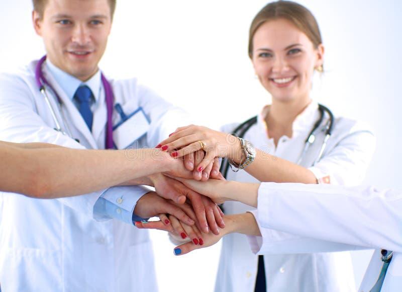 Médecins et infirmières dans un empilement d'équipe médicale photo stock