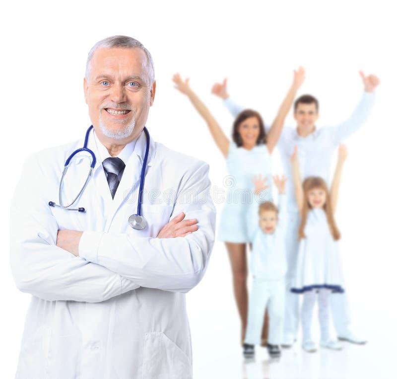 Médico de família e pacientes. imagem de stock
