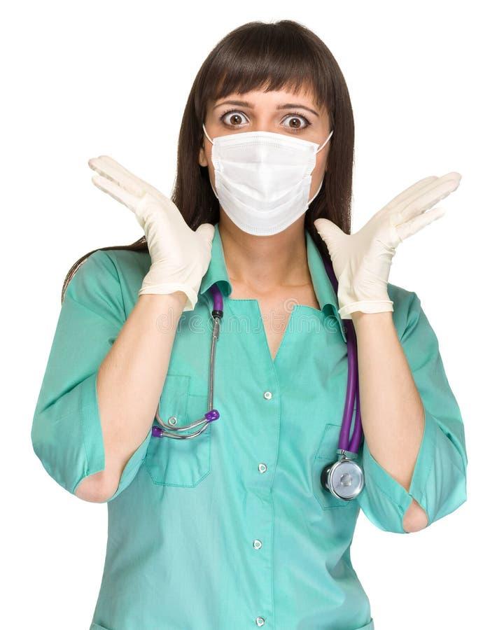 Médico fêmea surpreendido com a máscara isolada fotos de stock royalty free