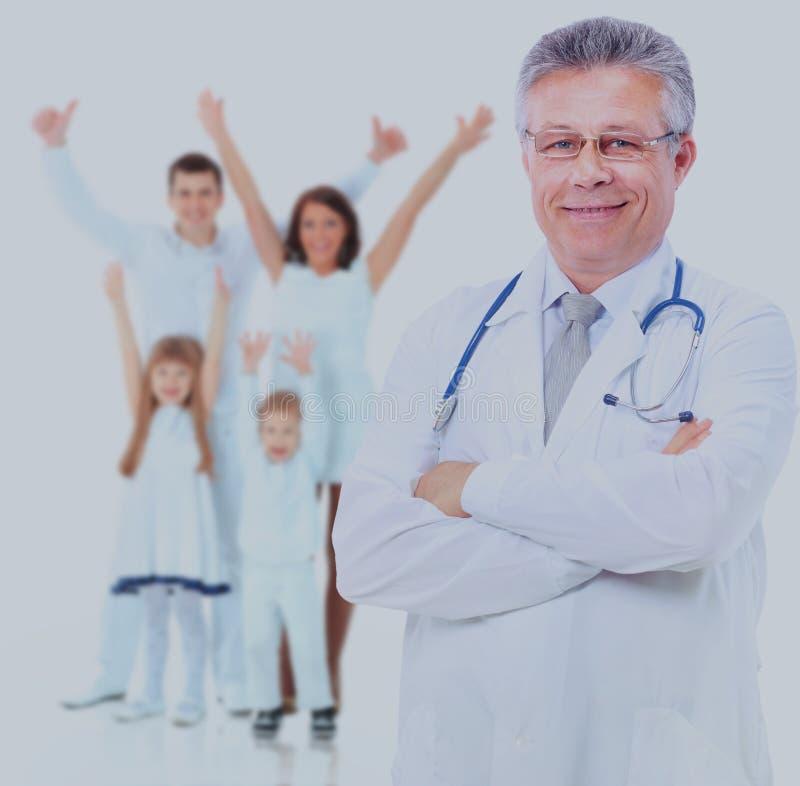 Médico sonriente Aislado sobre el fondo blanco fotografía de archivo