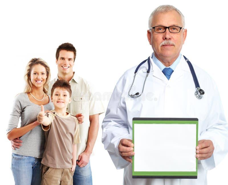Médico y pacientes médicos de cabecera imagen de archivo libre de regalías