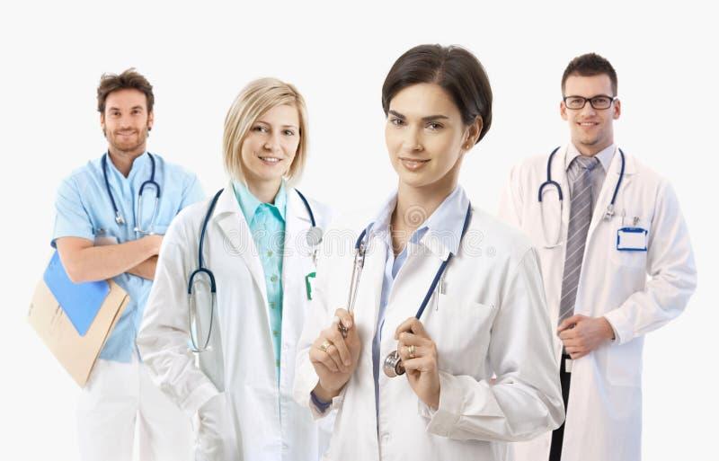 Médicos no fundo branco, retrato fotografia de stock