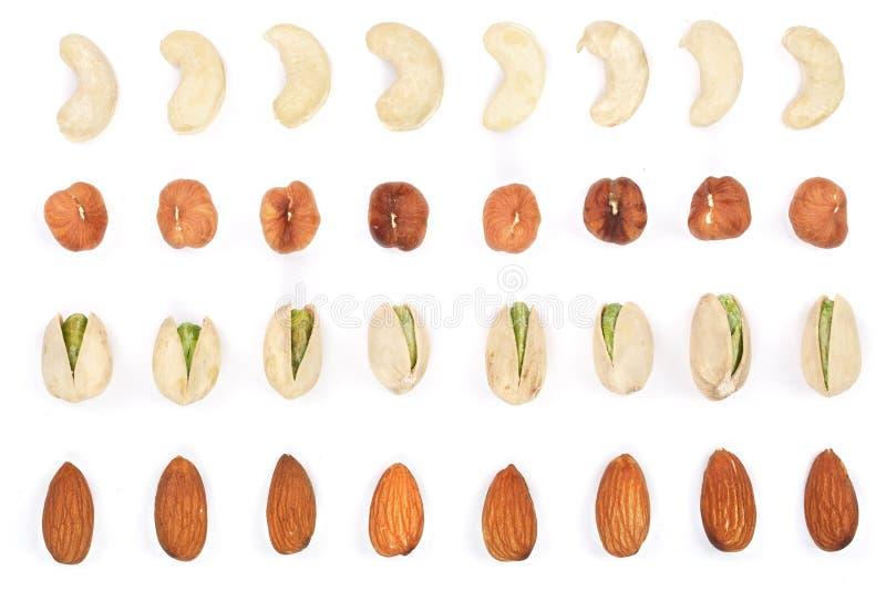 Mélangez les amandes nuts, pistaches de noisettes d'anarcadiers d'isolement sur le fond blanc Vue supérieure Configuration plate image libre de droits