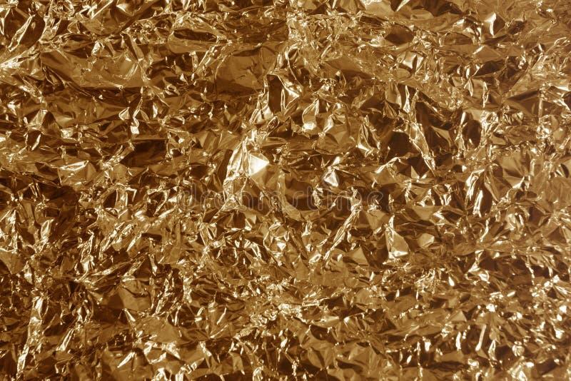 Métal en bronze chiffonné images libres de droits