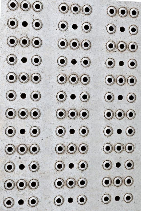 Métal gris de fond de trou texture dure de trous de design industriel de beaucoup de rangée verticale ronde de base photos libres de droits