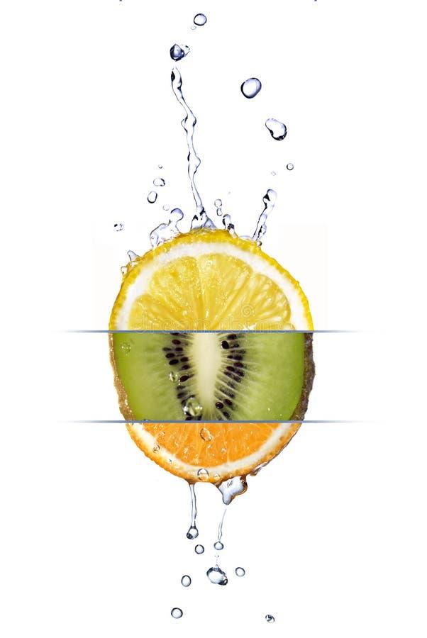 Mézclese del limón, de la naranja y del kiwi imagen de archivo libre de regalías
