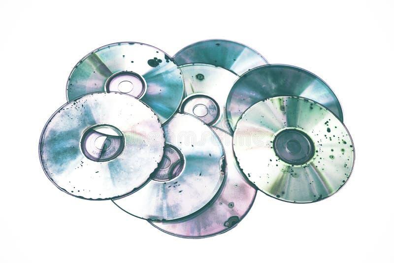 Mídia óptica de CD DVD danificada em fundo branco imagens de stock