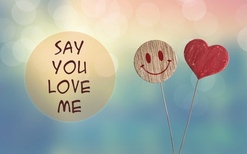 Mówi ty kocha ja z sercem i uśmiecha się emoji zdjęcie stock